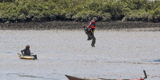 Loading Westpac Rescue Helicopter helps recover two stranded kayakers from the mudflats at Herald Island, Auckland. Photo / Greg Bowker