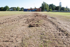 The Tauranga Domain cricket outfield is badly damaged in some areas after the One Love Festival. Photo / John Borren