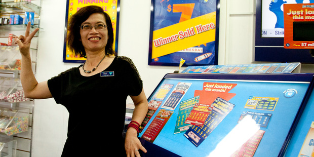 Linda Zeng from AJ's Lotto in Tauranga was stoked her store sold another winning ticket. Photo / Ruth Keber