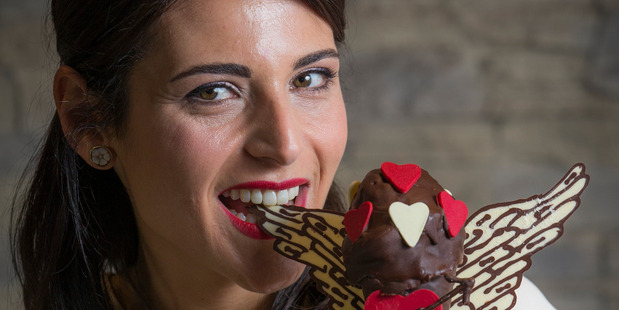Anna Grazioli with the Cupid inspired icecream that their Queens Street shop is doing for Valentines Day. Photo / Greg Bowker