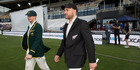 Australian and New Zealand captains Steve Smith and Brendon McCullum walking onto the pitch for the toss in the first test at the Basin Reserve. Photo / Mark Mitchell.