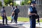 Armed police and forensic police at Glenvil Lane, Te Atatu, after Cunxiu Tian (left) was found dead in her home on Friday afternoon. PHOTO/NZME