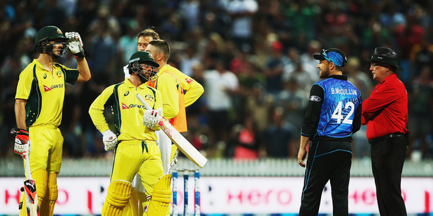 Loading Mitchell Marsh of Australia waits as the umpires watch a replay with Brendon McCullum of the Black Caps during the 3rd One Day International. Photo / Alan Gibson.