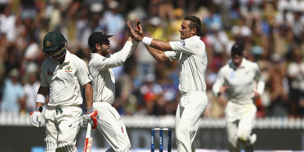 Tim Southee of New Zealand celebrates after taking the wicket of David Warner of Australia during day one of the Test match between New Zealand and Australia. Photo / Getty Images.