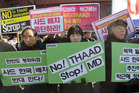 South Korean protesters stage a rally to oppose the possible deployment of the United States' advanced defense system THAAD, a Terminal High-Altitude Area Defense, on Korea Peninsula. Photo / AP