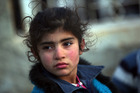 A Syrian child arrives at the Bab al-Salam border crossing as thousands flee the Syrian Government offensive. Photo / AP