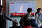 A South Korean soldier watches a TV news program showing an image of unidentified object flying in the sky. Photo/ AP
