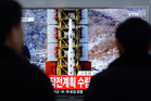 People watch a TV news reporting a rocket launch in North Korea. Photo / AP