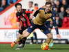 Arsenal's Aaron Ramsey, right, and AFC Bournemouth's Harry Arter battle for the ball during the English Premier League soccer match between Bournemouth and Arsenal. Photo / AP.