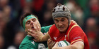 Wales' Jonathan Davies, right, hands-off Ireland's CJ Stander in action during their 2016 Six Nations rugby match at the Aviva Stadium in Dublin. Photo / AP.
