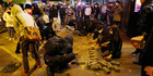 Protesters collect bricks from a pathway during clashes with police in Mong Kok district of Hong Kong. Photo / AP