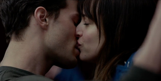 Christian Grey played by Jamie Dornan and Anastasia Steele played by Dakota Johnson in the film adaptation of the novel Fifty Shades of Grey.