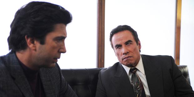 David Schwimmer as Robert Kardashian, John Travolta as Robert Shapiro.
