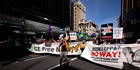 Protesters walk down Queen St, Auckland, over the government's TPPA trade deal. Photo / Dean Purcell
