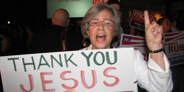 A woman supporting Marco Rubio,  who won the Florida Senate seat, says God is behind him. Photo / AP