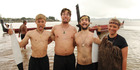 Dutch kaihoe (paddlers), from left, Diederik Thompson, Thomas Driessen, Alex Miesen and Mirte Hazes during Waitangi Day commemorations on Tii Beach. PHOTO / PETER DE GRAAF