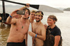Dutch paddlers (from left) Thomas Driessen, Diederik Thompson, Alex Miesen and Mirte Hazes send a message to friends in Holland from  Tii Beach. Photo / Peter de Graaf