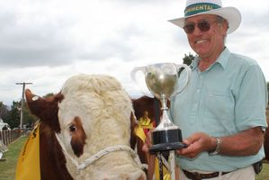 Tony Thompson of Waipukurau's Glen Anthony Simmental Stud, with the Meat and Wool Cup won by his bull, Glen Anthony Yale - Yogi Bear to his friends - at the Dannevirke and Districts A&P Show last weekend. Photo / Christine McKay