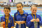 Young Dannevirke swimmers excelled at the Wellington long course summer championships. Christian Falloon (left) won a gold medal in the 9-year-old boys 100-metre backstroke; Lily Martin, 11, qualified for the New Zealand junior championships in the 50m backstroke and Stevye  Bishop won a silver medal in the 9-year-old girls 50m backstroke and a bronze in the 100m backstroke.