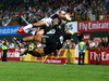 Zack Test of the USA is tackled by in the air by Augustine Pulu of New Zealand. Photo / Getty Images.