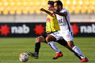 Diego Castro of the Glory and Matthew Ridenton of the Phoenix compete for the ball during the round 18 A-League match between Wellington Phoenix and Perth Glory. Photo / Getty Images.