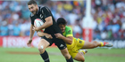 Joe Webber of New Zealand is tackled by Allan Fa'alava'au of Australia during the 2016 Sydney Sevens cup final match between Australia and New Zealand. Photo / Getty Images