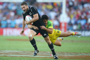 Joe Webber of NZ is tackled by Allan Fa'alava'au of Australia. Photo / Getty Images