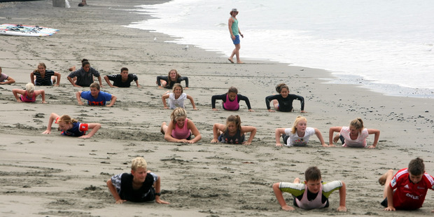 The Nippers surf lifesavers from Westshore, Napier, train in overcast conditions yesterday. Photo / Paul Taylor
