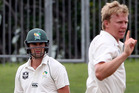 Scott Kuggeleijn celebrates the wicket of Tom Bruce. Photo / Duncan Brown, Hawke's Bay Today