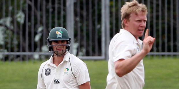 Scott Kuggeleijn celebrates the wicket of Tom Bruce. Photo / Duncan Brown, Hawke's Bay Today
