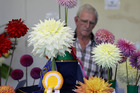 AWARD-WINNING: Peter Greene from Taradale with a Kea Magic (front left), grown by Waikanae's Phil Bothamley, which won the champion bloom. PHOTO/Duncan Brown
