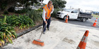 John Langley cleans up a DIY engine job gone wrong near Whangarei's Hatea Loop walkway. Photo / John Stone