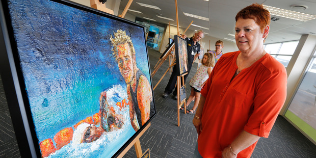 Jan Peck from Ruakaka checks out the painting of Paralympian Cameron Leslie in the Kauri Room at the Hub, at Whangarei Town Basin. Photo / John Stone