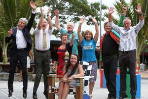 """Project action group members Barry Trass, Ian Reeves, Pam Tothill, Ben Pittman, Helen Whittaker, Jenny Hill, Andrew Garratt and Clive Jackson celebrate the $4 million boost outside Whangarei's """"Hundertwasser HQ"""". Photo / Michael Cunningham"""