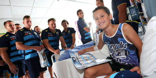 STOKED: Anthony Murray-Paniona, 9, got to meet members of the Gold Coast Titans team yesterday when they visited the children's ward at Whangarei Hospital. If he recovers he may be taking the field ahead of them at Toll Stadium today. PHOTO/MICHAEL CUNNINGHAM