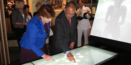 "Arts, Culture and Heritage Minister Maggie Barry and Governor-General Sir Jerry Mateparae try out an ""interactive table"" allowing visitors to find and share images."