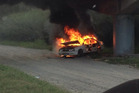 A car was spotted engulfed in flames.