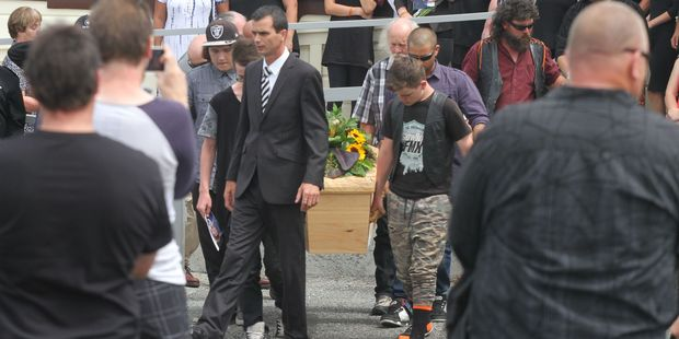 The casket of teen Pacer Willacy-Scott is carried from the Anzac Hall in Featherston at a memorial service for the 15-year-old. PHOTO/ANDREW BONALLACK