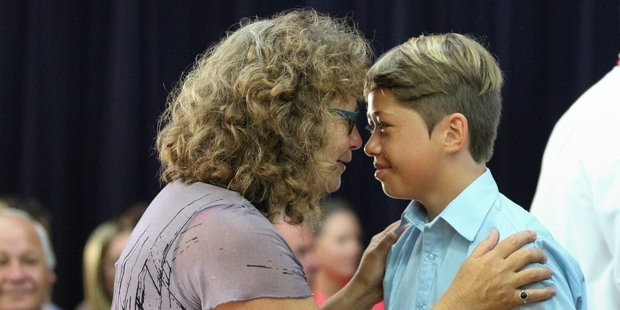 Kuranui College Te Reo Maori teacher Suzanne Murphy welcomes new Year 9 student Koby McCarthy during a powhiri to welcome the fresh crop of students to the school. Photo / Catherine Rossiter-Stead