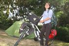 Maya Zhang, a Chinese tourist that was robbed of her bike and belongings in Carterton, shows off her newly donated bike and luggage, and tent. PHOTO/ANDREW BONALLACK