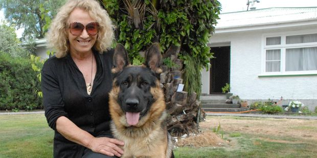 Sue Oomen with her German shepherd Bruza, who she nursed back to health after he contracted tetanus when he was three months old. PHOTO/EMILY NORMAN