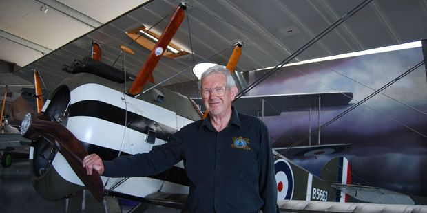 Vintage aviator senior tour guide Scott Thomson beside the original Sopwith F.1 Camel Scout which has recently gone on display.