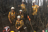 The Northland crew of firefighters get dirty on the ground while fighting fires in Tasmania.
