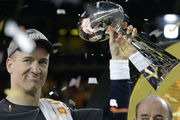 Peyton Manning with the Super Bowl trophy. Photo / AP