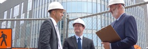 Left to right - Stuart Bent and Neil Parker of Bayleys Property Services discuss health and safety requirements on a commercial building site with Kevin Williams, director Health and Safety NZ Ltd.