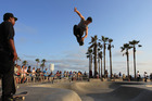 Isaac Mercado makes a jump on rollerblades at Venice Beach, California. Air fares between New Zealand and California have just dipped to below $400 one way. Photo / Getty