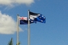 New Zealanders will soon vote whether to keep the current flag, left, or the silver fern on a blue and black background flag, in the upcoming referendum. These flags are flying atop Forum North, in Whangarei. Photo / Mike Dinsdale