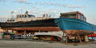 The ochre-coloured paint on the bottom of most boats is copper-based anti foul paint.