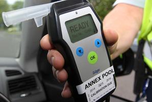 The woman blew a breath alcohol reading of 935mcg per litre of breath.