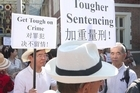 Several members of the Chinese community gathered outside the High Court this morning as the 19-year-old man accused of murdering and sexually violating a woman at her home appeared.